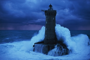 a-lighthouse-braces-itself-against-the-ocean-in-a-picture
